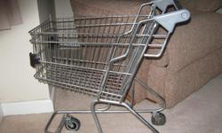 Two child-size metal shopping carts. They are the type that grocery stores have for children. Fully operational. Made by JNE Retail Equipment in Calgary. I have custom made plexiglass tops for each cart for use as a small table. Carts are both plain