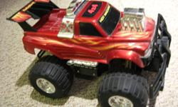 Remote control HOT MACHINE truck, 4 wheel drive, 7 functions, 4 wheel suspension, high/low gear selection for extra speed or hill climbing. $12.00 worth of battries included. Like new condition.
