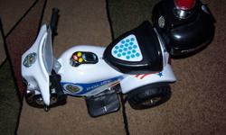 FOR SALE SMALL POLICE ELECTRIC MOTORCYCLE.USED ONLY INSIDE VERY GOOD CONDITION, COMES WITH REGULAR WALL CHARGER.PRICE 50$. THANKS