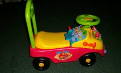 Winnie the Pooh fire engine walker, can be used to help child walk and then they can ride around, plays music when buttons are pushed