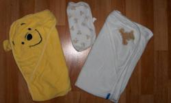 Bath Robes: Both washed but never used. Yellow Duckie Carter's Brand 0-9 months - $5 White Robe 12 months - $5 Hooded Towels gently used - $5 for both or take everything for $12!