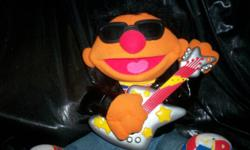 "Rock and Roll Ernie.... He sings "" Splish Splash "" and more.... his arm goes up and down as he plays his guitar..........in perfect condition. He sits over a foot tall, and takes 3 aa batteries...."