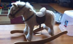 Our son has outgrown his toy. Soft, plush, sturdy rocking horse for a toddler. It neighs and clip/clops. $20