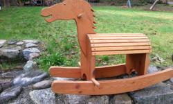 One very cool little wooden rocking horse. Granddaughter is outgrowing her things. $35.00 obo