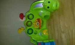 Dinosaur roll-a-round with lights and sounds. Put the balls in the holes and wait to see where it will come out. Bubble gum roll-a-round toy with lights and sounds. Put the balls in the top and pull the lever to make them come out. Roll-a-round creature