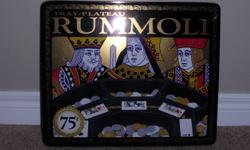 We are selling our Rummoli Game for best offer. It is in excellent condition. Contains all pieces. Playing cards are not included. Can be delivered. **Check out my other ads**