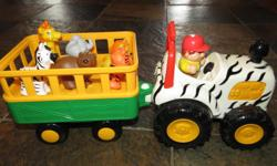 Includes jeep with trailer, driver, 6 animals, animal sounds, drives when push button.