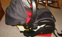 -black and red checkered car seat in great condition, gently used for one baby. -includes base and head support pad. -expires 2014, lots of time left to use! -manual instructions are also included