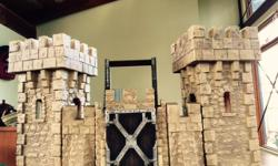 """**New price** Majestic """"stone"""" castle with 2 towers, 4 walls, 2 connecting elements and a working drawbridge. Pieces connect in different arrangements to create your own custom castles. Measures 34"""" x 18"""" x 16.5"""" - size is matched to the Schleich knights'"""