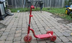 Red children's scooter. Excellent condition.