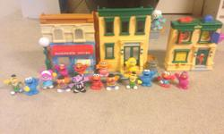 Daycare closing. Two Sesame Street buildings with lots of characters. $20