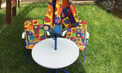 Sesame street four piece kids patio set. Can be used indoors or outdoors. Chairs and table close for easy storage. Round table measures: 51cm L x 51cmW x 46cm H two patio chairs: 37cm W x 37cm L x 51cm H umbrella height 128cm. Pick up only. View my other