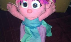 DOLL with dress she in on Sesame Street like NEW very cute very soft doll non- smoking home push on her tummy and will talk to you also sings Made by Hasbro Hillside- Bay She retails for $29,99, new my doll is like new no marks on her at all just marked