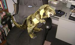 """Set of 4 beautiful giant plush dinosaurs.  I photographed them sitting in our computer chair to give an idea of their size.  They are soft filled, but also have """"scales"""" painted on parts of their bodies.  They also have flexible plastic claws.   These are"""