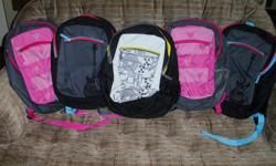 """As seen in the picture, this is a set of 5 brand new backpacks with 3 designs in total. Each backpack measures about 18"""" high and 14"""" wide, and comes complete with am attached pencil case. These backpacks have never been used, and would be good for"""
