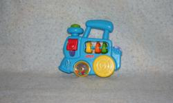 Fisher Price train that makes noises, wheels turn and beads rattle. Fisher Price Rings - like new - no bite marks Fisher Price shape set - all pieces are included. Fisher Price Push Ball Popper