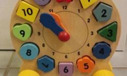 Wooden clock to learn to tell time and shapes. Smoke and pet free home.