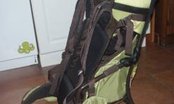 Sherpani Rumba Superlight in green.  No rips/tears/stains - excellent condition from non-smoking home. This backpack is great for carrying baby around- baby is fully supported at sides and with straps, foot holders there for taking weight off and so baby