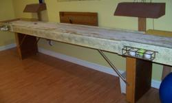 "Shuffleboard table (176"" X 28.5"") with solid playing surface.  Includes one set of deluxe stainless steel rocks."