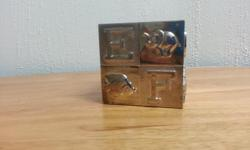 Silverplated with blue velvet bottom. Good condition. Letter and animal design. Makes a great baby gift.