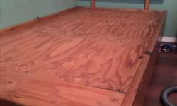 Single bed locally made out of a waterbed frame. Very sturdy bed. The legs can be removed so that the bed sits right on the ground which is great for toddlers. Mattress not included.