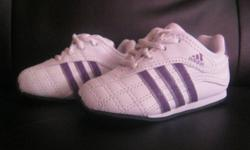 I have a pair of purple Adidas size 4 shoes. Just bought daughter didn't fit them. Asking 25.
