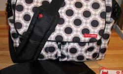 Skip Hop brand diaper bag, Dash Deluxe model in Blossom pattern.  In excellent lightly used condition.  Purchased new 6 months ago from Dear-Born baby in Toronto for $79 plus tax, I am asking $35.  Straps attach easily to any stroller handles.  Please