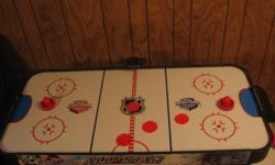 """Small NHL air hockey table for sale, including accessories.  Approximately 54"""" x 23"""". The digital scoreboard is no longer functional.  Home is smoke & pet-free.   Need to get rid of this as moving."""