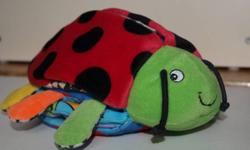 This Ladybug is a Cuddly Pal plus a Soft Story Book.  Ladybug Pal has patterns under her wings and sounds & textures inside her feet.  The Book on her tummy features bright colorful patterns, three-dimensional flaps to lift, textures and sounds, along