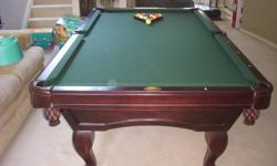 Solid Oak Pool Table on 1 inch slate. Just like new. Beautiful design and very rich looking. 8'x4' Includes Que rack, 6 Ques and balls.