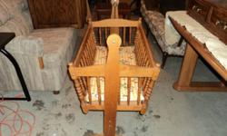 """1-used solid wood with brass hangers, baby bassinet in fair condition, nice quality with light baby mattress.   33"""" long     18"""" wide   $125.00   call or text Steve 250-317-5478   For an extra $10 can deliver to Kelowna or West Kelowna"""