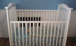 Solid wood baby crib, with mattress.  $200 obo Can deliver in St.Catharines area.