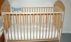 This baby crib is solid wood. It is sturdy but has a few tooth marks in it. It comes with a mattress and a crib sheet. It is about 8 yrs old and has been gently used with 3 children. The mattress has one small hole. It comes from a non smoking home.