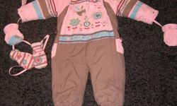 Sold seperately...One piece winter suit in very good condition (looks new, only used for one season). Matching hat and mittens sold with the suit. Fits baby from 12-18 months (bought for 200$). 18-24 months is 2-piece suit (bought for 150$. Both are very