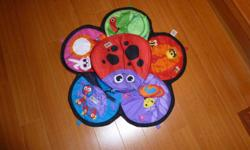 Excellent condition. Now you can enjoy tummy time with your little one with the Lamaze Spin & Explore. Babies gently and comfortably spin around on their tummies, stretching and building their upper body. It's colorful mat is loaded with textures,