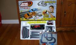 Slot Car Racing. Just spin and win. No batteries needed. Instructions included.