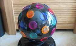 "Is in like new condition Black Finish Multicoloured Lights Dimensions: 8.5"" H x 7"" W"