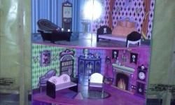 This doll house is 3 feet high, fits barbies and Monster High. Furniture is included