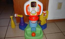 Keep's score, light's up and play's music. Good hand/eye coordination toy.