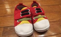 Squeeky running shoes squeek when baby walks; removable squeekers.  Size 4.  From smoke free home; see sellers' other ads.