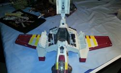 Star Wars Ship with Clone Trooper action figures. The Ship lights up and makes noises when you play with it. All in mint-condition. Also comes apart to make a smaller ship. Fun imaginative play toy for Star Wars fans!
