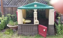 "Used but good condition Step 2 Playhouse. 48""W x 38""H x 31""D Delivery possible for small fee."