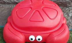 This Crab sand box in in very good condition!   There is no sun fading or cracks. Just finished presure washing it. VERY CLEAN!   Can be used as a sand box or pool. It has the lid so, you don't have to worry about any cat's.   1 bag of sand is included.