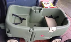 Step 2 Green Wagon for toddlers Easy-latch door opens to deep leg wells with molded-in drain holes Long handle facilitates pulling, and folds under wagon for transport and storage Two seat belts included Included under-seat storage $80 FCFS