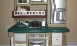 In excellent condition from a smoke-free, pet-free home. Comes with all accessories: pots & pans, dishes , utensils, salt & pepper shakers, lots of plastic food (fruit, veg, meat, canned goods, etc.). Stove top makes cooking sounds and lights up when pan