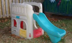 Used step 2 toddler slide for sale. Green slide with steps/ladder behind, a door and windows underneath to play house.
