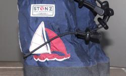 Navy blue with sailboats.  Size medium (6 - 18 months)
