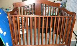 In the picture the crib is just leaning up aganist things. There is a drawer that goes below the crib, excellent for storing crib blankets and sheets. The daybed is an excellent size, and very easy to convert. Then as your child gets older it can convert