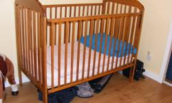 Beautiful oak crib, Lullaby III model. Excellent condition, but into a big girl bed now! Mattress could also be included. Please email for pictures, won't load for me.