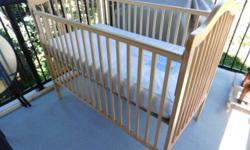 Stork craft crib natural wood finish with lite mate color. Sealy 15 year mattress. Has drop sides for access. There are three levels for the crib matress. Some bite marks on the crib railing.